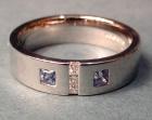 flush set art deco influenced platinum diamond and sapphire ring