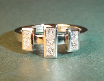 art deco inspired platinum ring with princess cut diamonds totalling 0.40cts