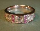 heavy platinum ring with diamonds and pink sapphires