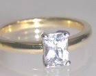 white sapphire solitaire ring in 18ct yellow and white gold