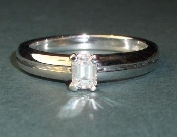 elegant art deco inspired 0.27cts emerald cut diamond solitaire
