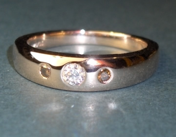 flush rose gold ring with white and chocolate cognac diamonds