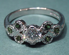 bespoke engagement ring with diamond and pave set tourmalines