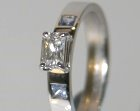 18ct white gold engagement ring with white and pale blue sapphires