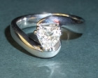 9ct white gold twist and heart shaped diamond engagement ring