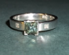 18ct white gold ring with rare princess cut green sapphire and diamonds