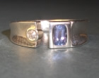 asymmetric silver and white gold concave ring with tanzanite and a diamond