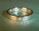 platinum ring with diamonds and latin engraving