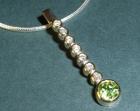bespoke diamond and peridot pendant