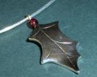 bespoke silver holly leaf and garnet pendant