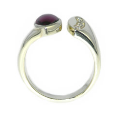 asymmetrical 9ct white gold, plum tourmaline and diamond engagement ring