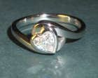 platinum 'embraced heart' diamond solitaire engagement ring