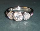 bespoke platinum and diamond ring with heart shaped shoulder diamonds