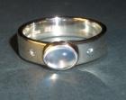 bespoke moonstone and aquamarine engagment ring