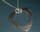 heart shaped sterling silver necklace and glasses holder