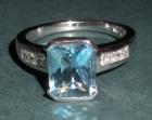 striking bespoke aquamarine and diamond engagment ring