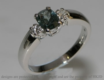 platinum engagement ring with diamonds and smoky green sapphire