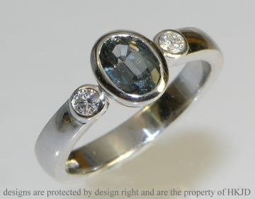 18ct white gold 1.02ct greensapphire and diamond engagement ring