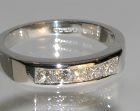 18ct white gold ring with princess cut channel set diamonds