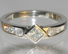 platinum princess cut diamond ring with graduated shoulder diamonds