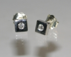 bespoke 9ct white gold earrings with two h si diamonds totalling 0.20cts