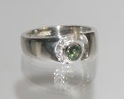 bespoke green sapphire and diamond engagement ring