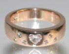 9ct rose gold engagement ring with heart shaped 0.22ct diamond and six 1.5mm brilliant cut diamonds