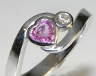 18ct white gold engagement ring with 0.48ct heart shaped pink sapphire and 2.5mmhsi diamond