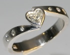 18ct white gold engagement ring with a 0.32ct heart shaped diamond and brilliant cut hsi shoulder diamonds