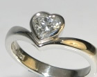 platinum engagement ring with 0.60cts hsi heart shaped diamond