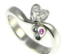 platinum two hearts engagement ring with 0.42cts hsi heart shaped diamond and pink sapphire