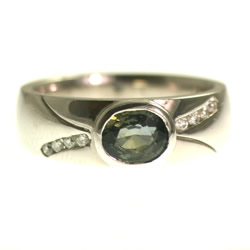 18ct white gold 1.29ct oval green sapphire engagement ring