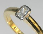 18ct yellow gold engagement ring with a white sapphire
