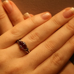 plum tormaline platinum engagement ring