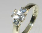white gold engagement ring with white and pale blue sapphires