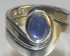 platinum engagement and wedding ring with a cabochon blue sapphire