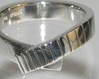 commissioned platinum wrap over ring