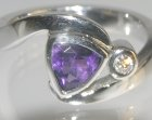 9ct white gold commissioned ring with a trillion cut amethyst