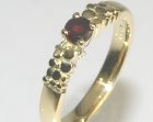 18ct yellow gold commissioned ring with a deep red garnet