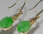 pair of 9ct yellow gold commissioned earrings with oval jadite