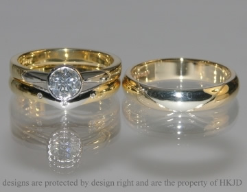Pair of commissioned engagement ring and fitted wedding rings