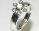 bespoke flower inspired moonstone and sapphire engagement ring