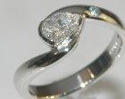 bespoke platinum diamond and topaz twist style engagement ring