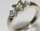 18ct white gold, green sapphire and diamond engagement ring