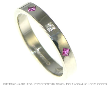 white gold sapphire and diamond eternity ring