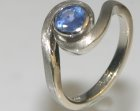 engagement ring with 5.1mm 0.55ct cornflower blue sapphire