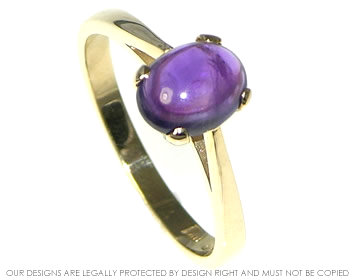 medieval styled 9ct yellow gold ring with cabochon cut amethyst