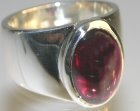 silver commissioned dress ring with a garnet