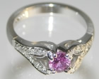 18ct white gold commissioned engagement ring with pink sapphire