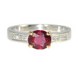 oval shaped bright red spinel, diamond and mixed metal engagement ring